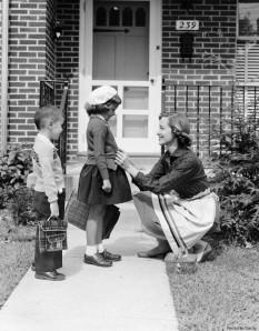 Mother seeing children off to school